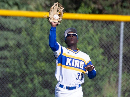 Milwaukee King outfielder Keshun Nelson makes a catch during the team's sectional final against Wisconsin Lutheran. King won, 5-4.
