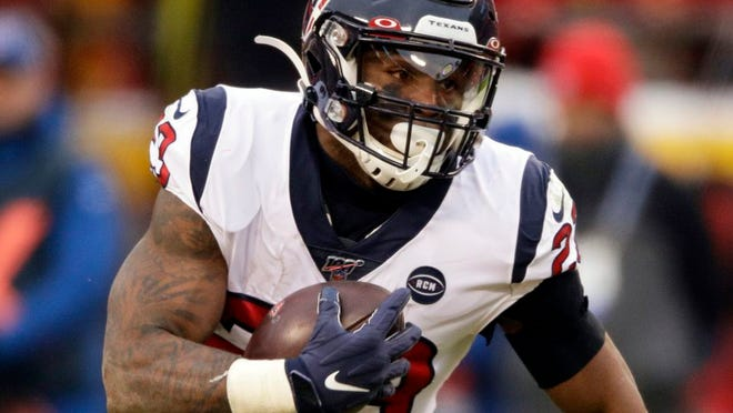 From Jan. 12, 2020, Houston Texans running back Carlos Hyde carries the ball during the first half of an NFL divisional playoff football game against the Kansas City Chiefs in Kansas City, Mo. Hyde has admired the Seattle Seahawks from afar for a while. So it made sense he would jump at the chance to sign with Seattle this offseason and build the depth in the Seahawks backfield.