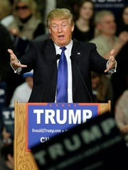 Republican presidential candidate Donald Trump speaks during a campaign rally at Clinton Middle School in Clinton, Iowa, on Saturday, Jan. 30, 2016.