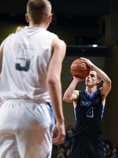 Sioux Falls Christian guard Lincoln Unruh (4) pulls