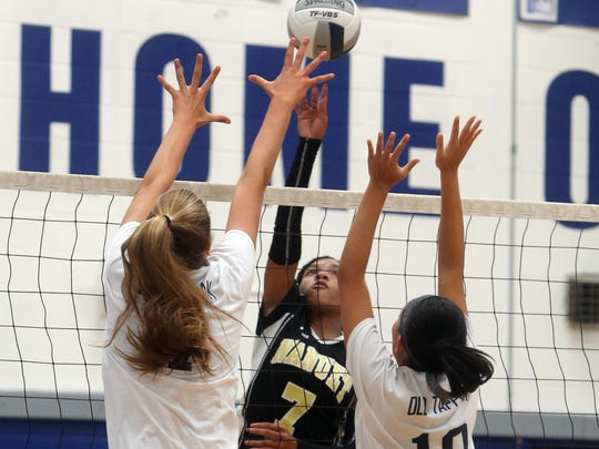 Nanuet's Kayla Diaz has her shot defended by Old Tappan