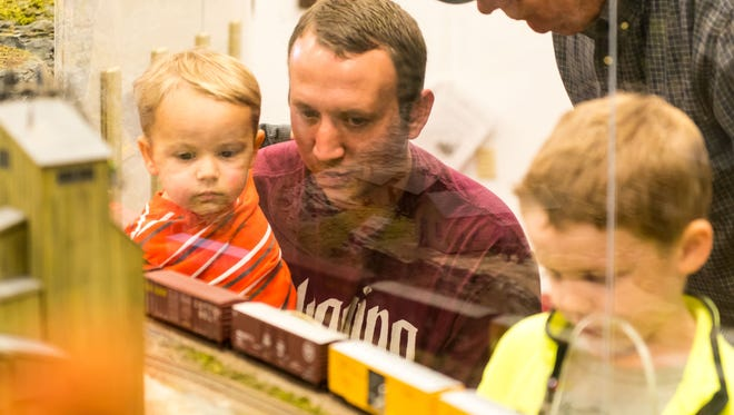 Timmy and Mike Wunderler watch over trains at the Patcong Valley Model Railroad Club in Richland on Saturday, November 19.