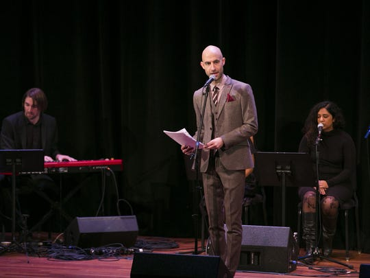 "Cecil Baldwin, center, on stage as part of a ""Welcome to Night Vale"" live show."