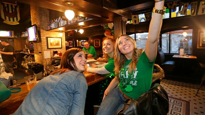 Sam Winner (far right) and friends Kathy Keelan (center) and Jessica Hurlebaus grab a group selfie at Trinity Three Irish Pubs on St. Patrick's Day in 2017.