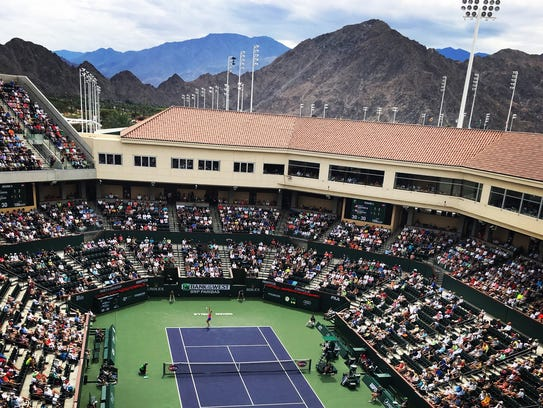 The beautiful view of the mountains and the tennis