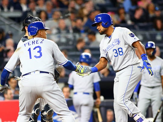 Kansas City Royals left fielder Jorge Bonifacio (38) is congratulated by designated hitter Salvador Perez (13) after hitting a two run home run against the New York Yankees during the seventh inning at Yankee Stadium.