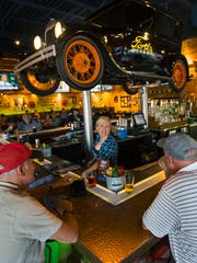 Diners line the bar at Ford's Garage in Estero. That