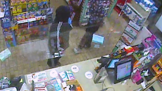 Adrian police released this image taken from security video of the suspects in the June 7 robbery of the 7-Eleven store in Adrian.