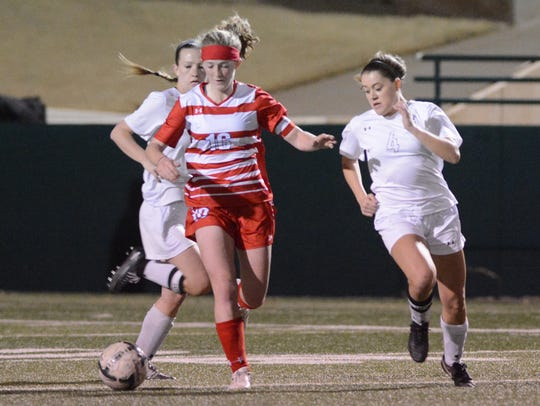 Cooper's Caylee Collier dribbles the ball away from