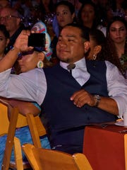 Vincent Gonzales III, Agua Caliente Band of Cahuilla Indians, Secretary/Treasurer catches a photo during the Dinner presentations.