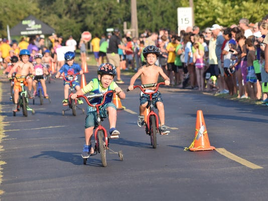 Youngsters participate in the cycling portion of the Wild Kidz Triathlon held Saturday, Aug. 29, 2015 at LSUA. About 300 children participated in the event sponsored by Run Wild which benefits Our Lady of Prompt Succor School.