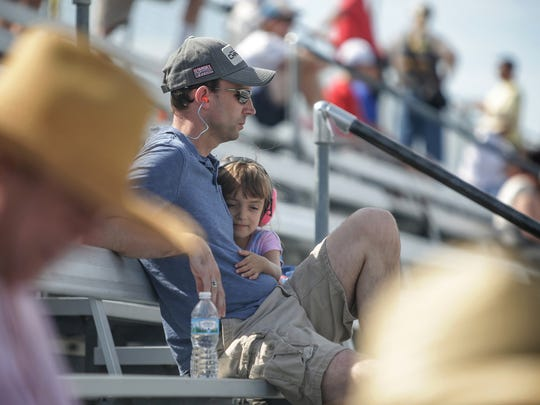 Brian Welling watches cars race by on the track with his daughter, Lilah, 4, at the SVRA Brickyard Vintage Race at Indianapolis Motor Speedway on Saturday, June 17, 2017.