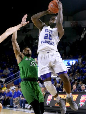 MTSU's Giddy Potts (20) goes up for a shot as Marshall's CJ Burks (14) defends him on Saturday.