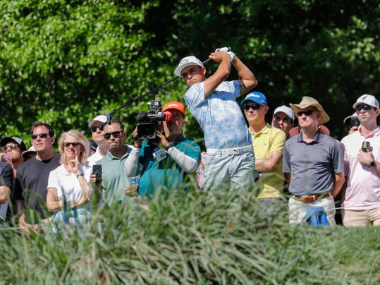 Rickie Fowler plays his shot from the tenth tee during the second round of the Houston Open at the Golf Club of Houston on March 30, 2018. (Tim Warner /Houston Chronicle via AP)