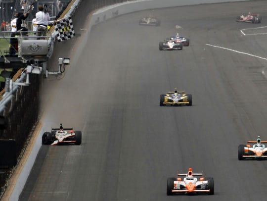 Dan Wheldon, front, wins the 100th anniversary Indianapolis