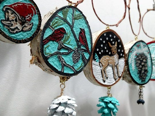 """Carved birch wood ornaments by Erin Nolan, part of """"Art Show 12: The Ornaments Show"""" Dec. 3 at Plum Bottom Pottery & Gallery."""