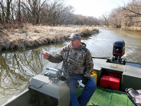 Ronnie Wolfe, a business owner and lifelong resident of Quasqueton, points to wetland projects on the Wapsipinicon River in northeast Iowa. He wants to add an oxbow on 80 acres he owns along the river to reduce flooding in communities downstream.