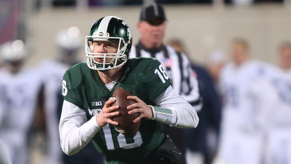 Michigan State Spartans Connor Cook passes against