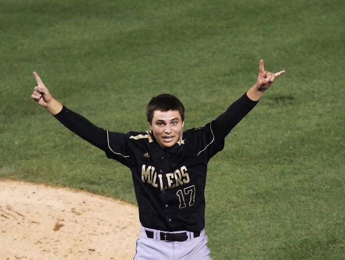 Noblesville pitcher Trevor Salmon celebrates after the last out. Noblesville defeated Terre Haute North 2-1 for the 4A state championship at Victory Field Friday June 20, 2014.