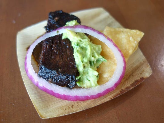 GOLD MEDAL: Smoked beef brisket with chile negro and guacamole from Elote Cafe at the Devour Culinary Classic 2017.