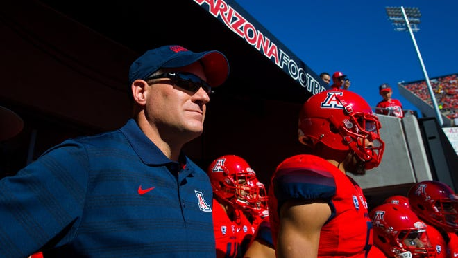 Arizona Wildcats head coach Rich Rodriguez (left) with his players prior to the game against the Arizona State Sun Devils during the 88th annual Territorial Cup at Arizona Stadium. The Wildcats defeated the Sun Devils 42-35 to win the Pac-12 South title.