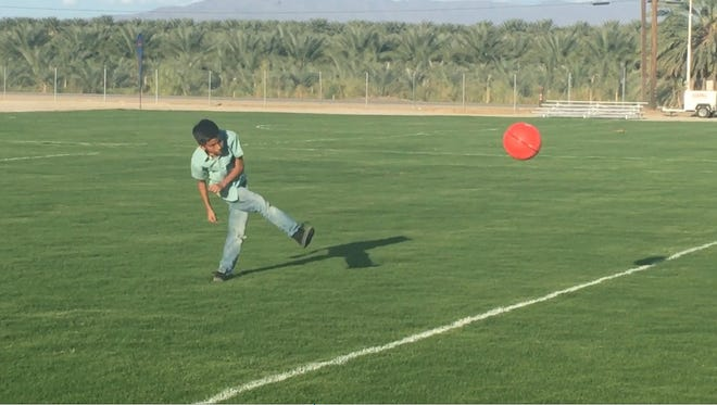 A child christens the first Oasis public soccer field, which was unveiled Sept. 8 by the Desert Recreation District.