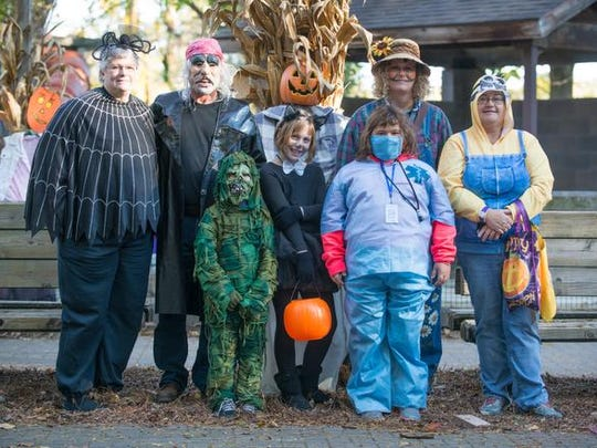 From left (back row): Barb and Jim Baumgarner and Leslie Edler. From left (front row) Adam (6), Allison (9), Riley Michael (8) and Susan Michael traveled from Homer for the Zoo Boo event held at the Binder Park Zoo Sunday afternoon.