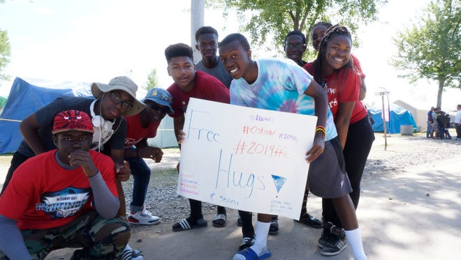 A Pathfinder group from Maryland offer free hugs to other Pathfinders at the Pathfinder Camporee.