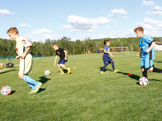 Kids work on practice drills Wednesday, June 1, 2016, at the Eastbay Sports Complex in Wausau.