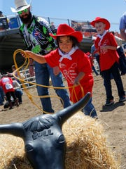 Jonah Chavez, 6, practices roping at the Special Buckaroos Rodeo at the 107th California Rodeo Salinas on Saturday.