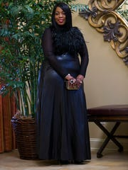 Jermonica Boardley wears a feathers and sheer top from Fashionable Fashions Boutique in Newark, New Jersey; TOV black leather maxi skirt from Hautelook; and black patent leather peep toe shoes by Paris Hilton.