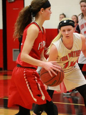 Norfork's Kinley Stowers guards Flippin's Makenna Johnson during the Lady Panthers' victory Tuesday night.