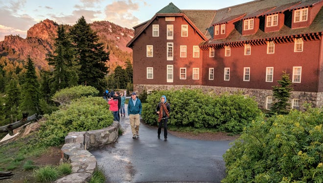 After a cool mid-June thunder shower passes, guests of the Crater Lake Lodge emerge to stroll the hotel's paths, which are right on the rim of the caldera.