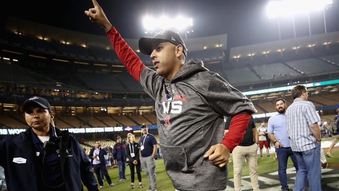 LOS ANGELES, CA - OCTOBER 28:  Alex Cora #20 of the Boston Red Sox celebrates his teams 5-1 win over the Los Angeles Dodgers in Game Five of the 2018 World Series at Dodger Stadium on October 28, 2018 in Los Angeles, California.  (Photo by Ezra Shaw/Getty Images) ORG XMIT: 775246752 ORIG FILE ID: 1054824094