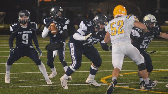 Rutherford quarterback Kyle Russell being protected