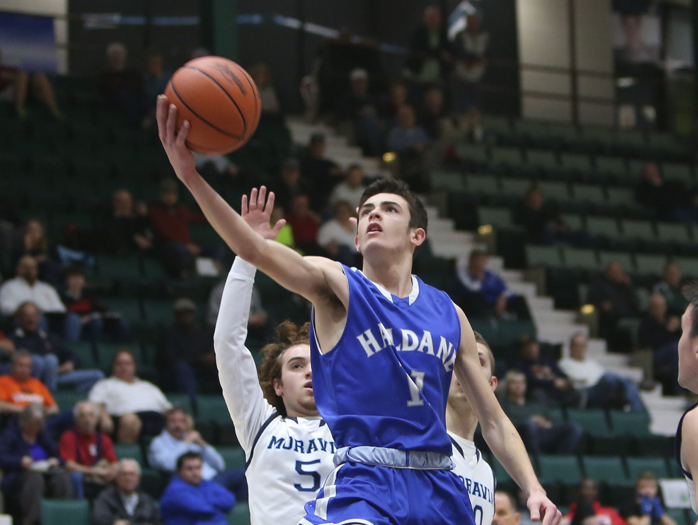 Haldane's Tucker Beachak (11) drives to the basket against Moravia during the boys Class C semifinal at the Glens Falls Civic Center March 11, 2016. Haldane won the game 36-34.