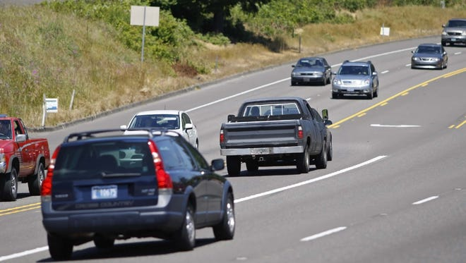 Cars wait to turn off of Highway 22.