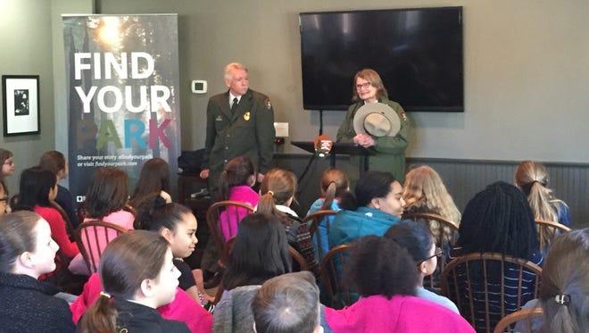 National Park Service Director Jonathan Jarvis listens at Sarah Olson, superintendent of the Roosevelt-Vanderbilt National Historic Sites, speaks to Hyde Park students.