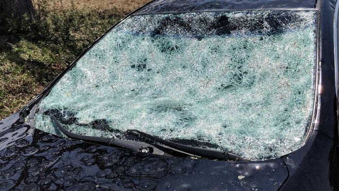 Softball-sized hail from a severe thunderstorm May 25, 2018, damaged this vehicle in Richland Springs, Texas.