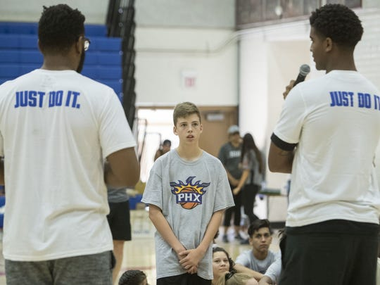 Josh Bleimeyer, 14, asks Phoenix Suns' Marquese Chriss and Alan Williams a question at North High School on Aug. 13, 2017 in Phoenix during a kids camp.