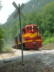 The Hiwassee Rail Adventure train approaches a grade crossing on its way up the Hiwassee Gorge last week near Benton, Tenn.