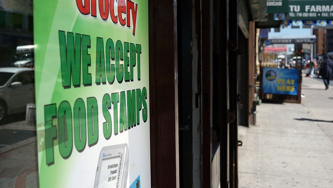 A grocery store advertises that they accept food stamps in the South Bronx In New York City.