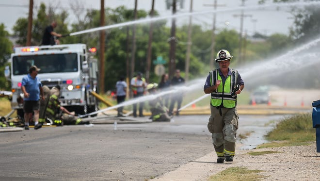 Todd Sanford, assistant chief of the San Angelo Fire Department, walks around a warehouse blaze Saturday, July 7, 2018, at 101 E. 3rd St.