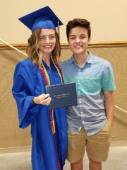 TJ Esser, right, celebrates the graduation of his sister