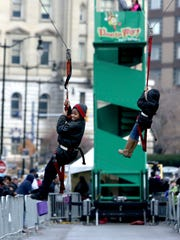 Two kids make their way down a zip line during the Meridian Winter Blast at Campus Martius Park on Saturday, Jan. 21, 2017 in downtown Detroit.