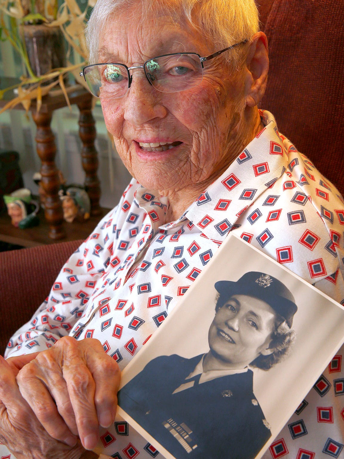 """Brick resident Alice """"Nora"""" Howes, 99, holds a photo"""