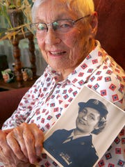 "Brick resident Alice ""Nora"" Howes, 99, holds a photo of herself in the Women's Army Corps, where she served from 1943-1970."