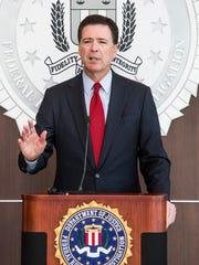 FBI Director James B. Comey speaks in Phoenix in 2014.