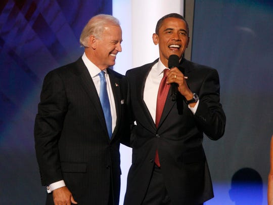 Barack Obama joins vice presidential nominee Joe Biden after he addresses delegates at the Democratic National Convention in Denver, Aug. 27, 2008.