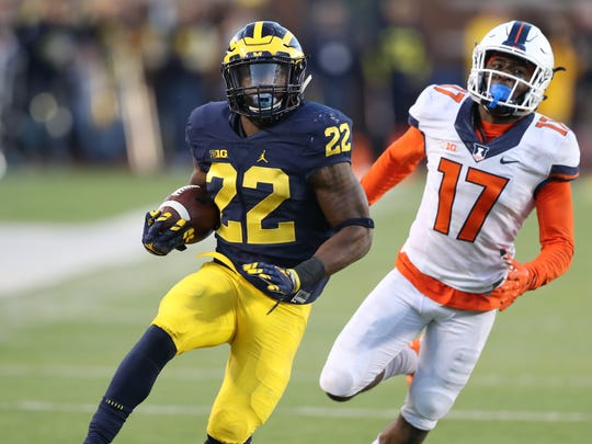 Michigan's Karan Higdon runs by Illinois' Stanley Green scoring a touchdown in the fourth quarter of U-M's 41-8 win Saturday at Michigan Stadium.